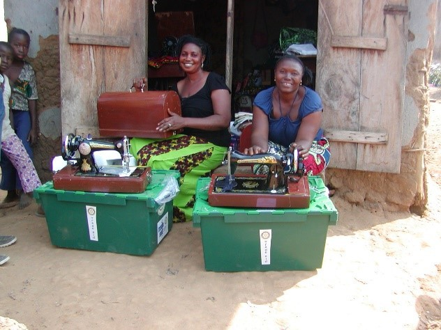 Girls receiving their sewing boxes